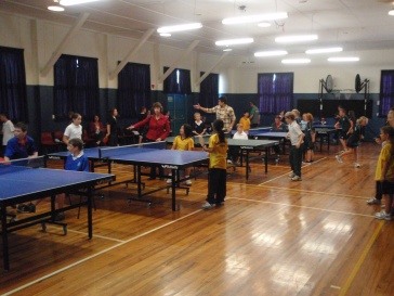 Children enjoying the competition inside the Waterloo school hall venue.