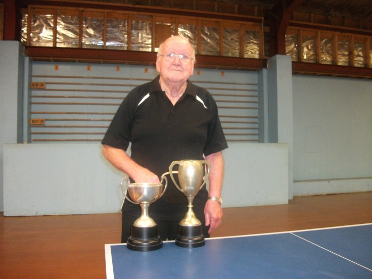 Hugh McIlwrath with the Over 80 Singles Cup and the Presidents Cup.