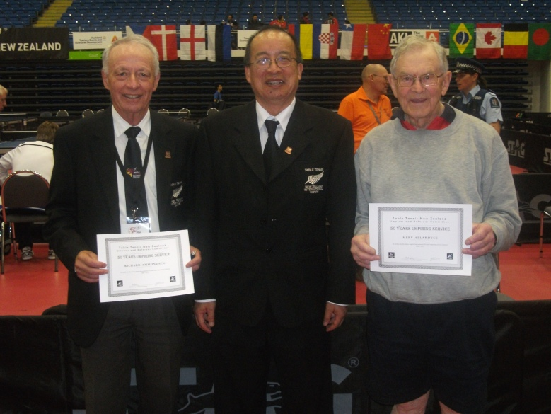 Richard Ammunden (Left) and Merv Allardyce (Right) receiving their 50 years umpiring service certificates from Malcolm Wong (URC).
