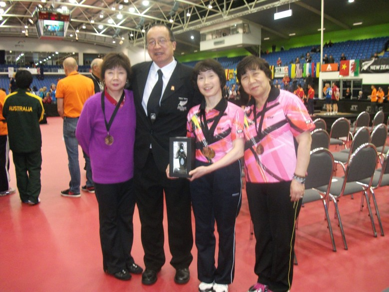 Malcolm Wong with the 2014 World Veteran Women's  Over 50 Singles Champion Toshiko Kataoka (Japan) to right of him.