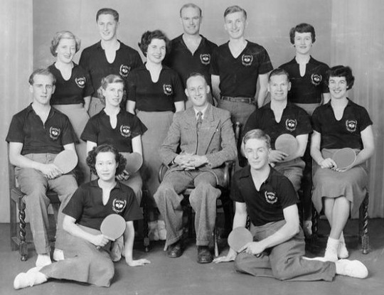 1953 Wellington Table Tennis Men's and Women's Teams. L/R back standing: Thyra McGregor, John Sigley, Eileen Brown, John Crossley, Murray Dunn, Pat Quinn  Center seated: Colin Shewan, Audrey Hughes, Keith Pratt (manager), Laurie Wilson, Charlotte Savage Front On floor: Ann Wah, Tony Darroch