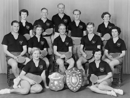 1954 Wellington Table Tennis Men's and Women's Teams.  Winners of the New Zealand Interprovincial Men's and Women's Teams Tournament. Left - Teague Shield (Women) and Kean Shield (Men). L/R: back: Pat Quinn, Ivan Houghton, John Crossley, Colin Shewan, Val Cousins Middle: John Sigley, Audrey Hughes, Tony Darroch, Murray Dunn, Eileen Brown Front: Thyra McGregor, Ann Wah