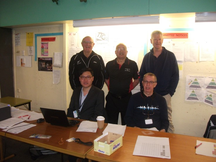 Standing: Gary William (TTNZ Chair), Malcolm Wong (Ump), Grant Wilson (Media and Broadcast Liason). Seated – Yi-Sien Lin (Tourn Dir) and Joachim Kusche (Tourn Ref).